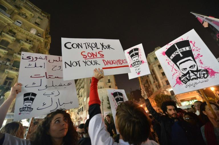 Protesters in 2013 hold up placards and shout slogans during a demonstration against sexual harassment in Egypt's capital Cairo (AFP Photo/Khaled DESOUKI)