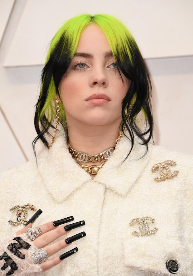 We never thought we would see Billie in an elegant updo, but we're obsessed (does it get any cooler than Chanel hair clips?). Her signature green roots keep it true to her edgy style, and those NAILS are to die for.