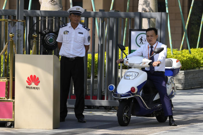 Security guards watch over an entrance to the sprawling Huawei headquarters campus in Shenzhen, China, Saturday, Sept. 25, 2021. Two Canadians detained in China on spying charges were released from prison and flown out of the country on Friday, Prime Minister Justin Trudeau said, just after a top executive of Chinese communications giant Huawei Technologies reached a deal with the U.S. Justice Department over fraud charges and flew to China. (AP Photo/Ng Han Guan)