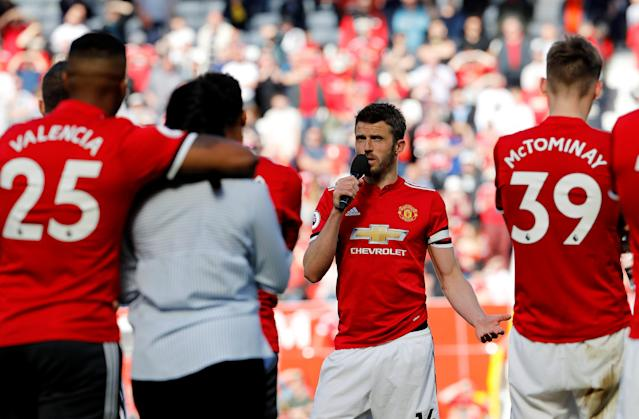 "Soccer Football - Premier League - Manchester United vs Watford - Old Trafford, Manchester, Britain - May 13, 2018 Manchester United's Michael Carrick speaks to the crowd after the match REUTERS/Darren Staples EDITORIAL USE ONLY. No use with unauthorized audio, video, data, fixture lists, club/league logos or ""live"" services. Online in-match use limited to 75 images, no video emulation. No use in betting, games or single club/league/player publications. Please contact your account representative for further details."