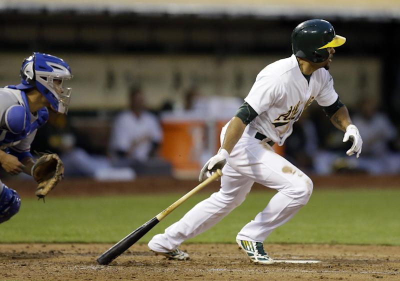Oakland Athletics' Coco Crisp drops his bat after hitting a two run single off Texas Rangers' Yu Darvish in the second inning of a baseball game Monday, April 21, 2014, in Oakland, Calif. At left is Rangers catcher Robinson Chirinos. (AP Photo/Ben Margot)