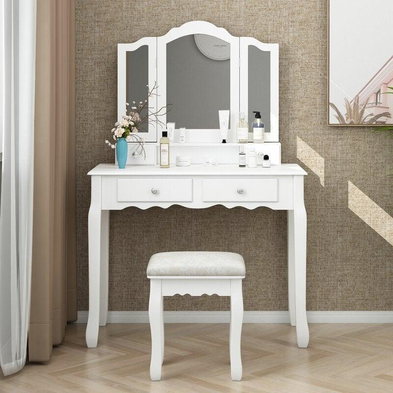 "Perfect for those looking for a more feminine, classic vanity. <br><br><strong><em><a href=""https://www.wayfair.com/brand/bnd/house-of-hampton-b37313.html"" rel=""nofollow noopener"" target=""_blank"" data-ylk=""slk:Shop Wayfair"" class=""link rapid-noclick-resp"">Shop Wayfair</a></em></strong><br><br><strong>House of Hampton</strong> Rippeon Makeup Vanity Set with Stool and Mirror, $, available at <a href=""https://go.skimresources.com/?id=30283X879131&url=https%3A%2F%2Fwww.wayfair.com%2Ffurniture%2Fpdp%2Fhouse-of-hampton-rippeon-makeup-vanity-set-with-stool-and-mirror-w002582367.html"" rel=""nofollow noopener"" target=""_blank"" data-ylk=""slk:Wayfair"" class=""link rapid-noclick-resp"">Wayfair</a>"