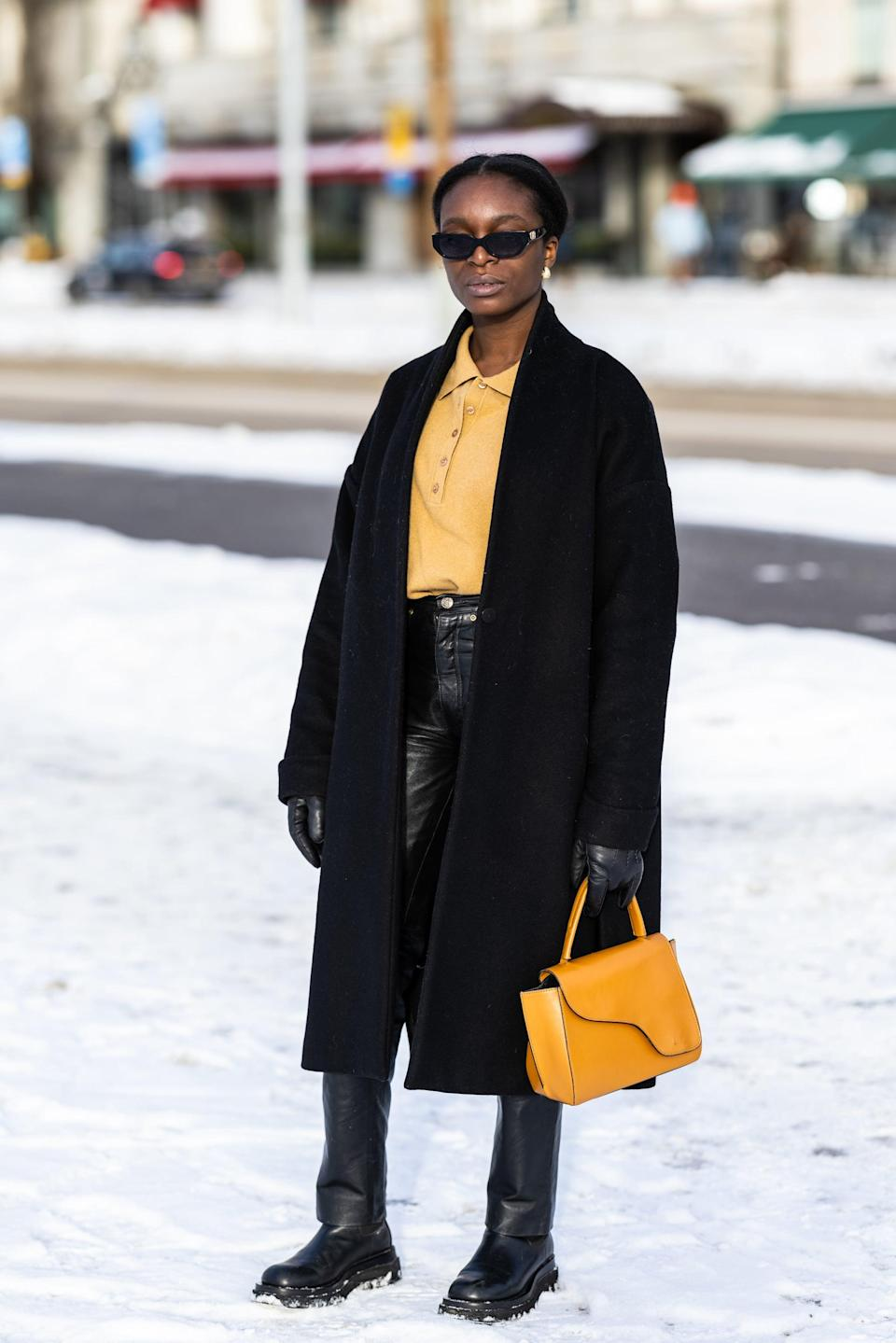 <p>Accent an all-black outfit with a bright bag and a matching shirt in a more muted tone.</p>
