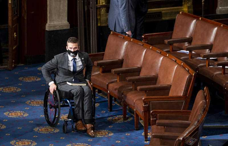 Republican Madison Cawthorn arrives on the House floor during the first session of the 117th Congress at the US Capitol in Washington.
