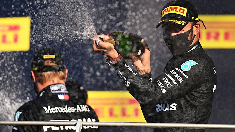 Race winner Lewis Hamilton and Mercedes GP celebrates on the podium after the F1 Grand Prix of Tuscany at Mugello Circuit. (Photo by Clive Mason - Formula 1/Formula 1 via Getty Images)