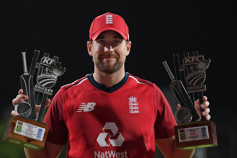 <p>Dawid Malan poses with his player of the match and player of the series trophies in Cape Town</p> (Getty Images)