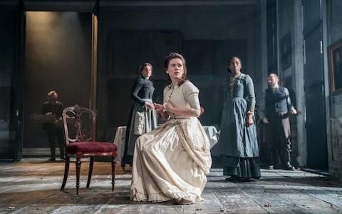Hayley Atwell (centre) in Rosmersholm - Credit: Johan Persson