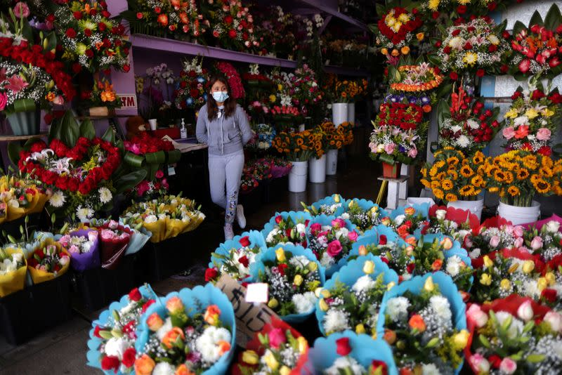 Florist Alvarez waits for customers at her store ahead of Valentine's Day in Los Angeles
