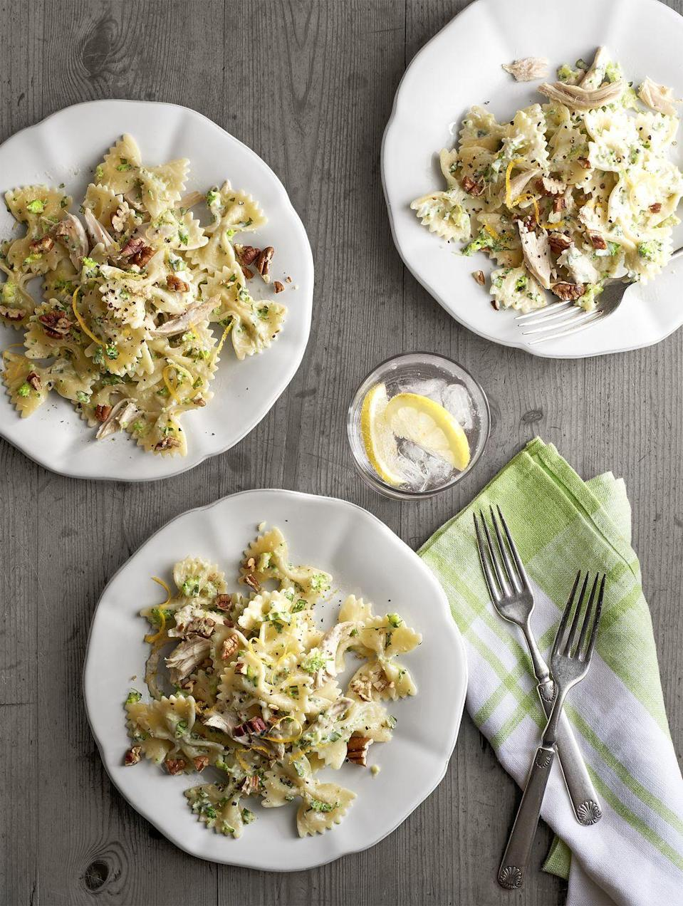"""<p>Toasted pecans add unexpected warmth and crunch to this creamy pasta dish.</p><p><a href=""""https://www.countryliving.com/food-drinks/recipes/a6297/creamy-chicken-broccoli-pesto-bow-ties-recipe-clx0215/"""" rel=""""nofollow noopener"""" target=""""_blank"""" data-ylk=""""slk:Get the recipe."""" class=""""link rapid-noclick-resp""""><strong>Get the recipe.</strong> </a></p>"""