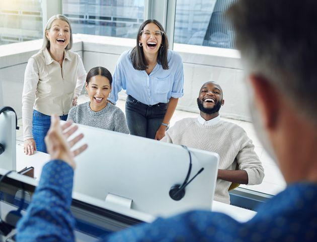 Adding a little laughter to the office (Photo: PeopleImages via Getty Images)