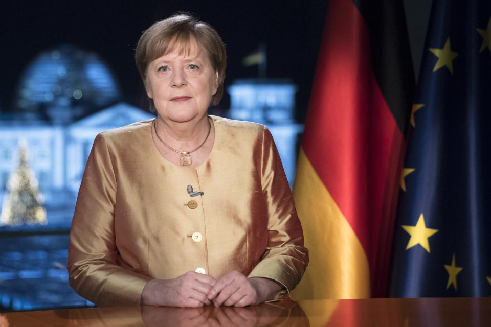 FILE - In this Dec. 30, 2020 file photo German Chancellor Angela Merkel poses for photographs after the television recording of her annual New Year's speech at the chancellery in Berlin. German Chancellor Angela Merkel's center-right party, the Christian Democratic Union, CDU, is choosing a new leader on the weekend Saturday Jan. 16 and Sunday Jan. 17, 2021, a decision that will help determine who succeeds Merkel at the helm of the European Union's biggest economy after a 16-year reign. Merkel, now 66, has steered Germany, and Europe, through a series of crises since she took office in 2005, she said over two years ago that she won't seek a fifth term as chancellor. (AP Photo/Markus Schreiber, File)