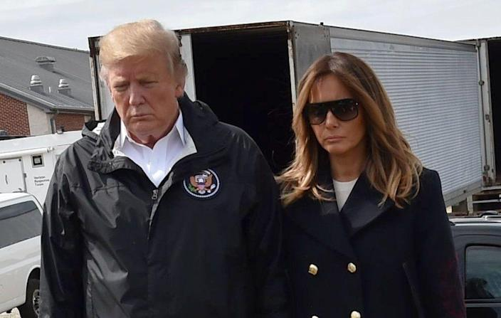 President Trump and first lady Melania Trump stand outside Providence Baptist Church in Opelika, Ala., during a tour of tornado-damaged areas on March 8. (Photo: Nicholas Kamm /AFP/Getty Images)