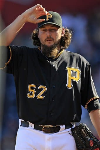 Pittsburgh Pirates closer Joel Hanrahan reacts to giving up a run-scoring double to Cincinnati Reds' Zack Cozart during the ninth inning of a baseball game against the Cincinnati Reds in Pittsburgh Sunday, Sept. 30, 2012. The Reds won 4-3, with Hanrahan taking the loss. (AP Photo/Gene J. Puskar)