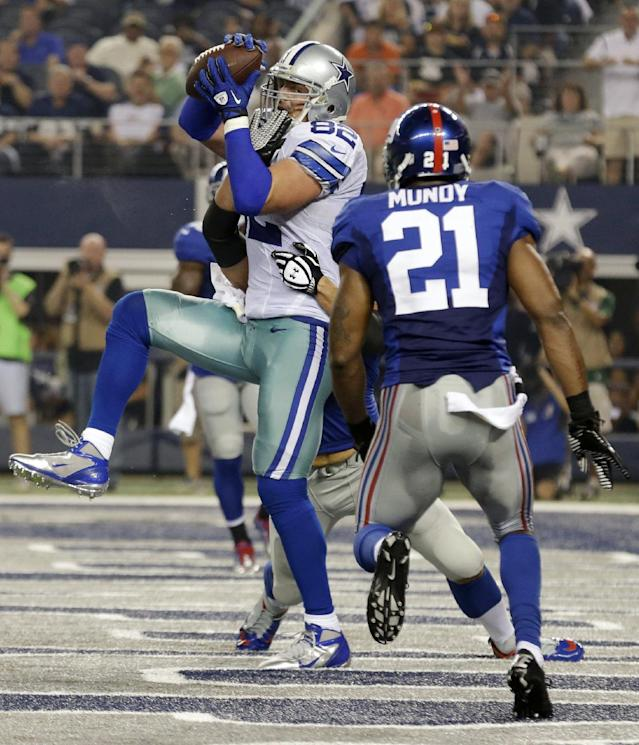 Dallas Cowboys tight end Jason Witten (82) makes a 15-yard touchdown reception from Tony Romo as New York Giants safety Ryan Mundy (21) defends during the first half of an NFL football game, Sunday, Sept. 8, 2013, in Arlington, Texas. (AP Photo/LM Otero)