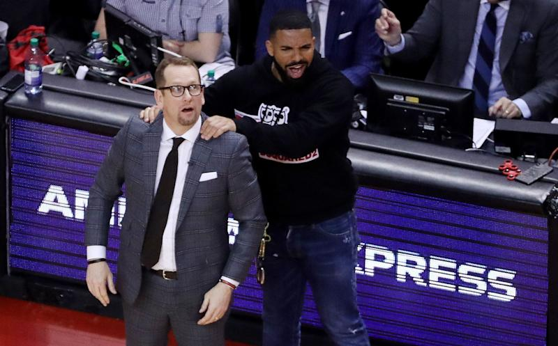 Drake massages Toronto Raptors head coach Nick Nurse's shoulder as the Toronto Raptors beat the Milwaukee Bucks in game four 120-102 to even up the Eastern Conference NBA Final at two games each at Scotiabank Arena in Toronto. May 21, 2019.