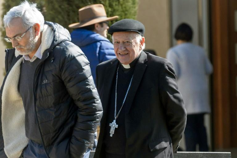 Archbishop Ricardo Ezzati (R) is pictured as he leaves a convention center near Santiago, after holding a meeting with members of the Chilean Episcopal Conference, on August 03, 2018