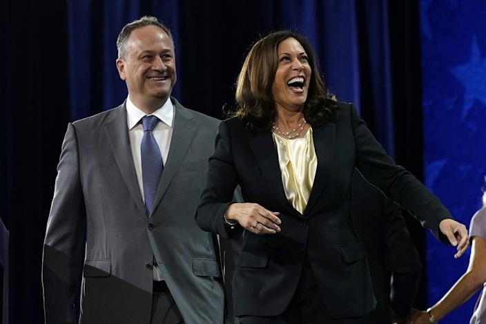 Democratic vice presidential candidate Sen. Kamala Harris, D-Calif., and her husband Doug Emhoff smile during the fourth day of the Democratic National Convention, Thursday, Aug. 20, 2020, at the Chase Center in Wilmington, Delaware.