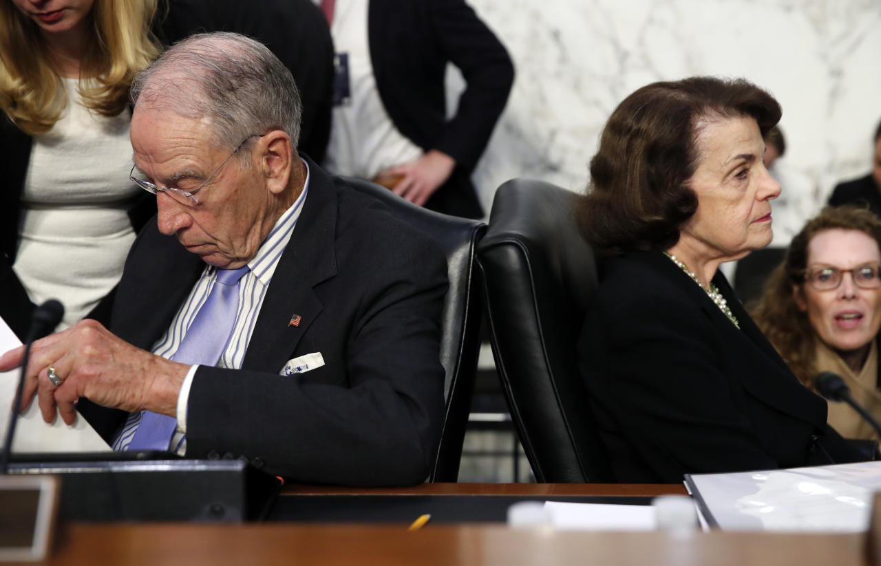 <p>Senate Judiciary Committee Chairman Chuck Grassley, left, R-Iowa, and Sen. Dianne Feinstein, D-Calif., the ranking member on the Senate Judiciary Committee, work with their aides during a break of President Donald Trump's Supreme Court nominee, Brett Kavanaugh testimony before the Senate Judiciary Committee on Capitol Hill in Washington, Thursday, Sept. 6, 2018, for the third day of his confirmation hearing to replace retired Justice Anthony Kennedy. (Photo: Alex Brandon/AP) </p>