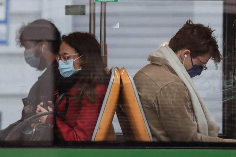 People wearing face masks to prevent the spread of COVID-19 sit on a bus, in Milan, Italy, Wednesday, Oct. 14, 2020. Italian Premier Giuseppe Conte says the aim of Italy's new anti-virus restrictions limiting nightlife and socializing is to head off another generalized lockdown. (AP Photo/Luca Bruno) (Photo: ASSOCIATED PRESS)