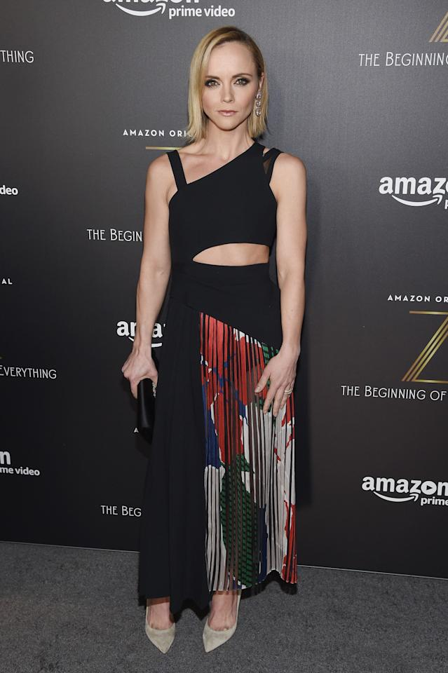 <p>Christina's cut-out Hugo Boss dress is a complete dream – especially with the addition of the floral pleats. <i>[Photo: Getty[</i> </p>