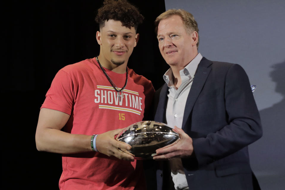 Patrick Mahomes shows off the spoils of victory, that included the Super Bowl MVP trophy, with commissioner Roger Goodell. Months later, Mahomes had a pointed message for Goodell. (AP Photo/Brynn Anderson, File)