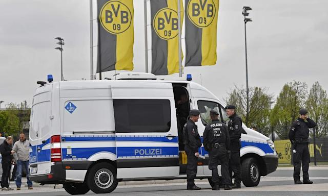 "<span class=""element-image__caption"">Police secure the Borussia Dortmund training ground before the postponed match against AS Monaco.</span> <span class=""element-image__credit"">Photograph: Martin Meissner/AP</span>"