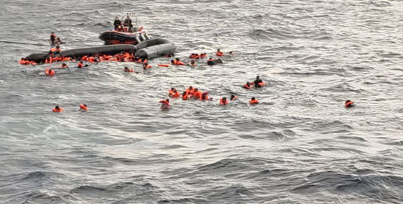 Migrants at sea waiting to be rescued by Spanish search and rescue ship Open Arms in the Mediterranean Sea