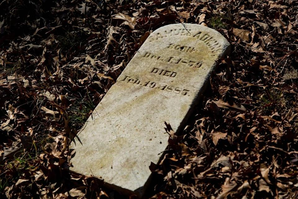 The oldest grave marker, from 1885, found in the Oak Grove Cemetery, which was founded by freed African-Americans after the Civil War and now has lost more of its tree buffer to widening of the I-440 Beltline, that separated it from the rest of the Method community in the 1960s, on Wednesday, Feb. 17, 2021, in Raleigh, N.C.