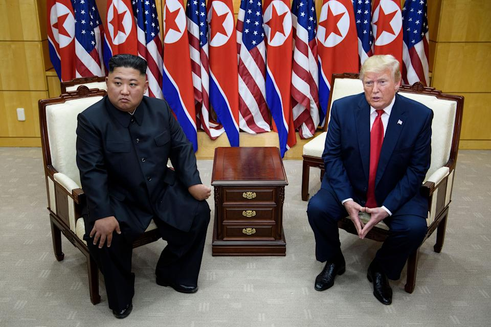 North Korean leader Kim Jong Un and President Donald Trump meet in the Demilitarized zone between North and South Korea on June 30, 2019. (Brendan Smialowski/AFP via Getty Images)