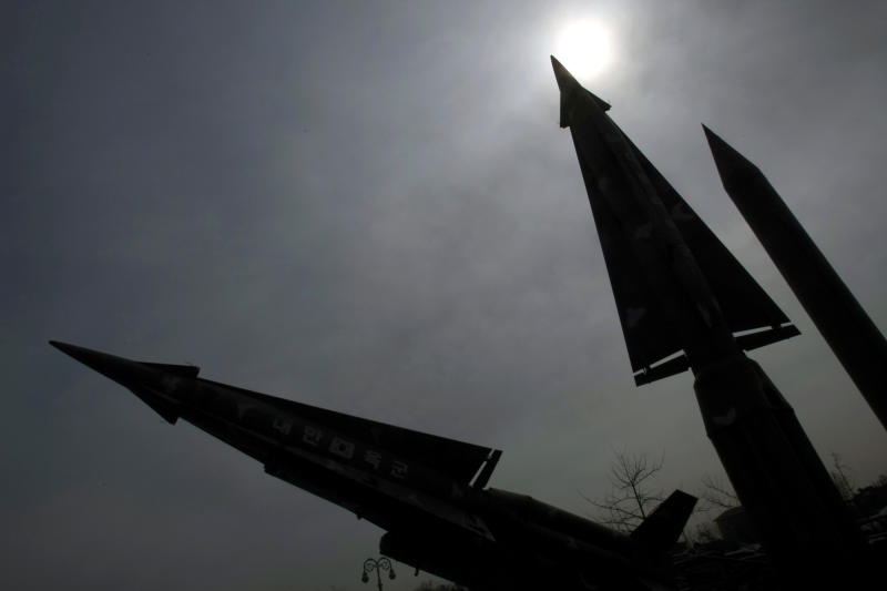 A mock North Korean Scud-B missile, right, and other South Korean missiles are silhouetted at the Korea War Memorial Museum in Seoul, Monday, March 19, 2012. North Korea vowed Sunday to go ahead with plans to launch a long-range rocket, rejecting criticism in the West that it would scuttle recent diplomacy. (AP Photo/Lee Jin-man)