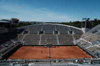 Czech Republic's Petra Kvitova, left, returns the ball to Belgium's Greet Minnen during their first round match of the French Open tennis tournament on the Suzanne Lenglen court of the Roland Garros stadium Sunday, May 30, 2021 in Paris. (AP Photo/Thibault Camus)