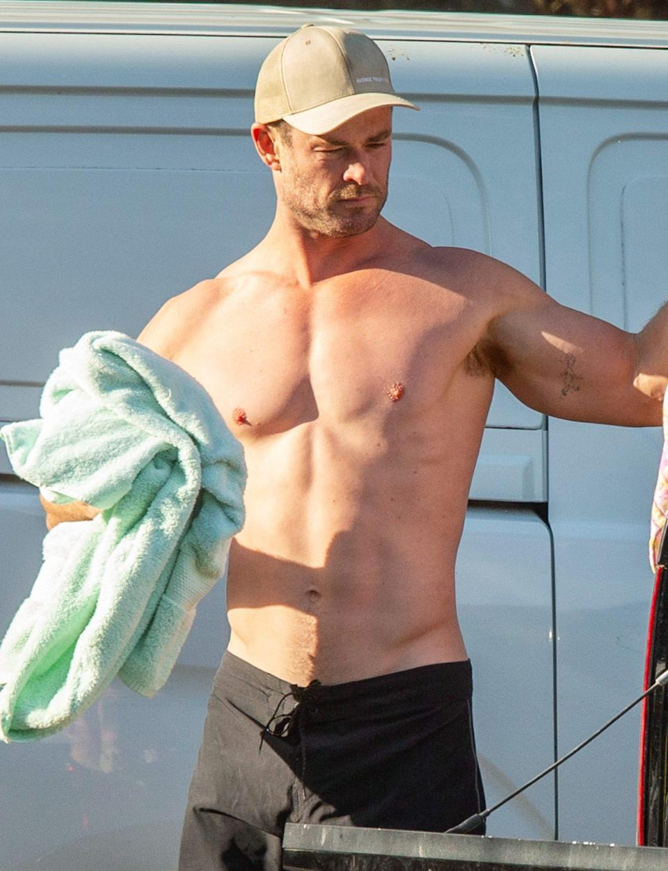 <p>Chris Hemsworth shows off his chiseled physique after hitting the beach in Byron Bay on Thursday. </p>