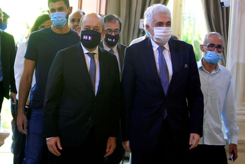 FILE PHOTO: French Foreign Affair Minister Jean-Yves Le Drian wears a face mask to prevent the spread of the coronavirus disease (COVID-19) as he meets with Lebanon's Foreign Minister Nassif Hitti at the Ministry of Foreign Affairs in Beirut
