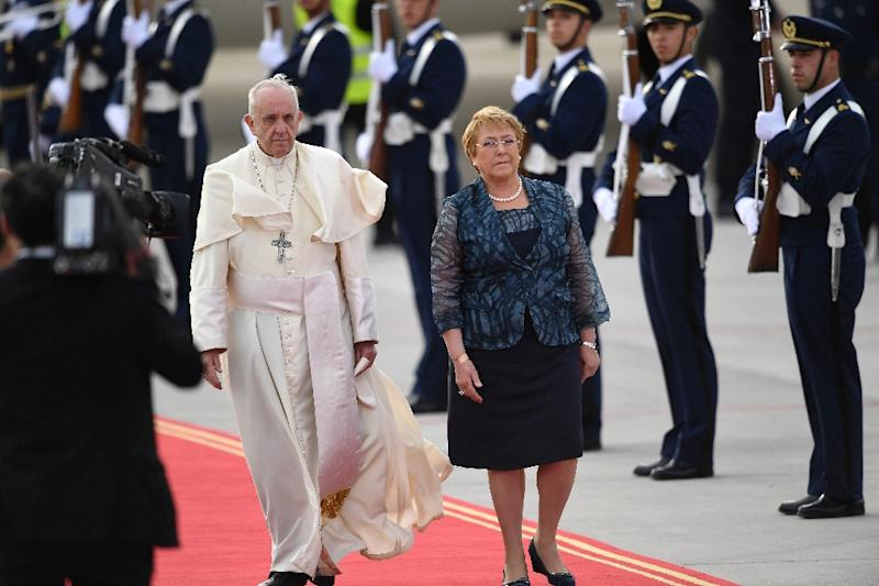 Chilean President Michelle Bachelet met Pope Francis upon his arrival at the Arturo Merino Benitez airport in Santiago (AFP Photo/Martin BERNETTI)