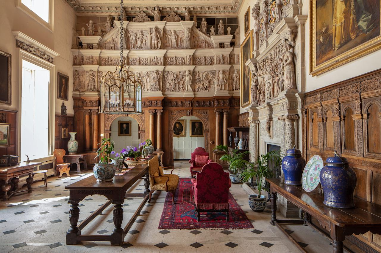 The great hall is filled with plasterwork, including a number of biblical figures.