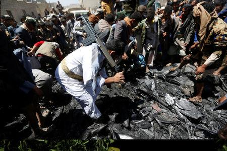Houthi militants collect parts of a drone aircraft which the Houthi rebels said they have downed in Sanaa, Yemen October 1, 2017. REUTERS/Khaled Abdullah