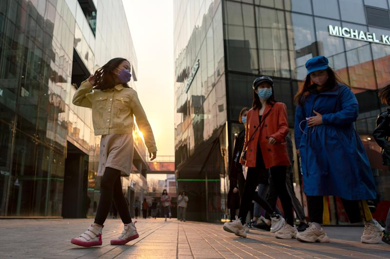 BEIJING, CHINA - MARCH 30, 2020: People wear protective face masks in a shopping and entertainment area in the Chinese capital. Since the start of the coronavirus outbreak in China, 93% of COVID-19 infected patients have recovered. The authorities imposed a two-week quarantine and took a number of measures to prevent a second wave of pneumonia. Artyom Ivanov/TASS (Photo by Artyom Ivanov\TASS via Getty Images)