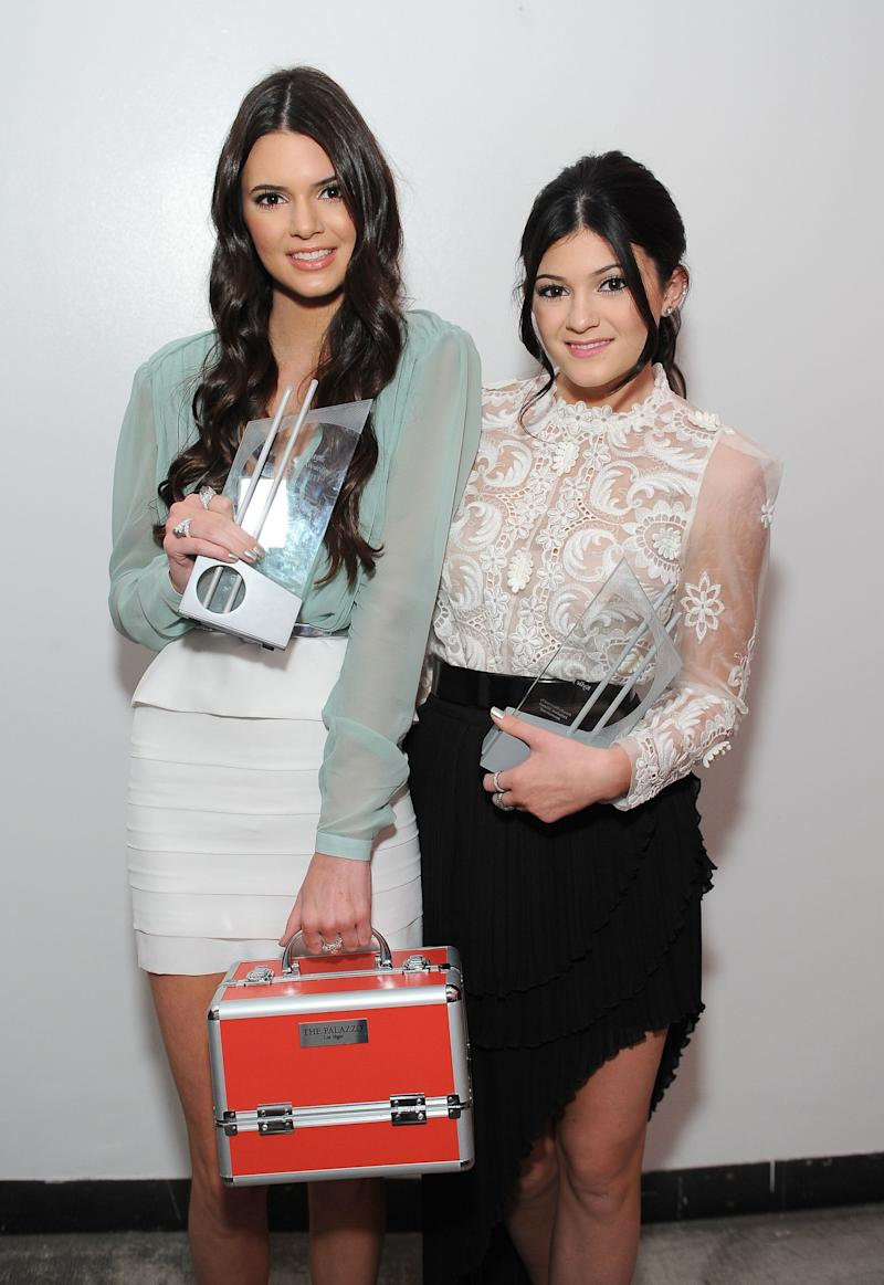 LOS ANGELES, CA - NOVEMBER 13: TV personalities Kendall Jenner (L) and Kylie Jenner pose with the 'Stylish Sisters' award at the 2011 Hollywood Style Awards sponsored by Smashbox, The Palazzo Las Vegas and Palladium Jewelry held at Smashbox Studios on November 13, 2011 in Los Angeles, California. (Photo by Michael Kovac/WireImage)