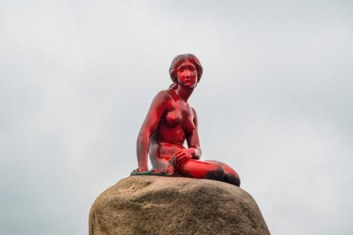 """The """"Little Mermaid"""" statue in Copenhagen, the city's most famous monument, was doused in red paint on Tuesday by animal rights activists outraged over whaling, police said."""