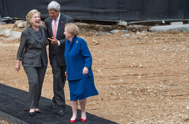 Then US Secretary of State John Kerry (C) talks with former US Secretaries of State Hillary Clinton (L) and Madeleine Albright (R) after breaking ground at the US Diplomacy Center at the US State Department in Washington, DC, September 3, 2014