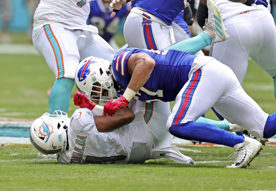 Miami Dolphins quarterback Tua Tagovailoa (1) is sacked by Buffalo Bills defensive end A.J. Epenesa (57) during first half of an NFL football game, Sunday, Sept. 19, 2021, in Miami Gardens, Fla. Tagovailoa was injured on the play. (David Santiago/Miami Herald via AP)