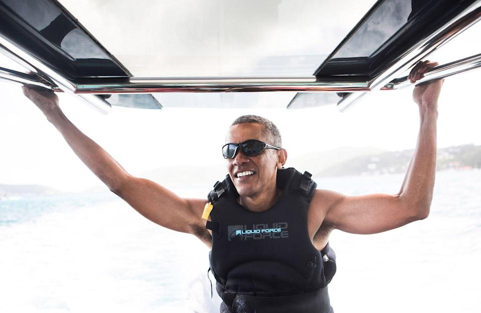 <p>Obama takes a break from kitesurfing to snap this incredibly viral photo. </p>
