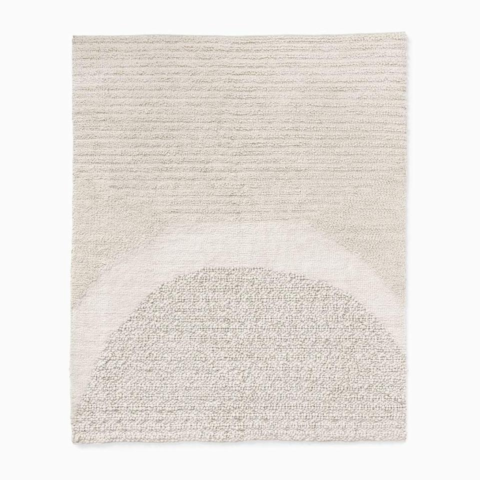 <p>We're firm believers that area rugs are the centerpiece of any room. You may not want something too overbearing, but that still has style so opt for yhe <span>West Elm Textured Arches Rug</span> ($400-$1,200). It looks incredibly soft.</p>