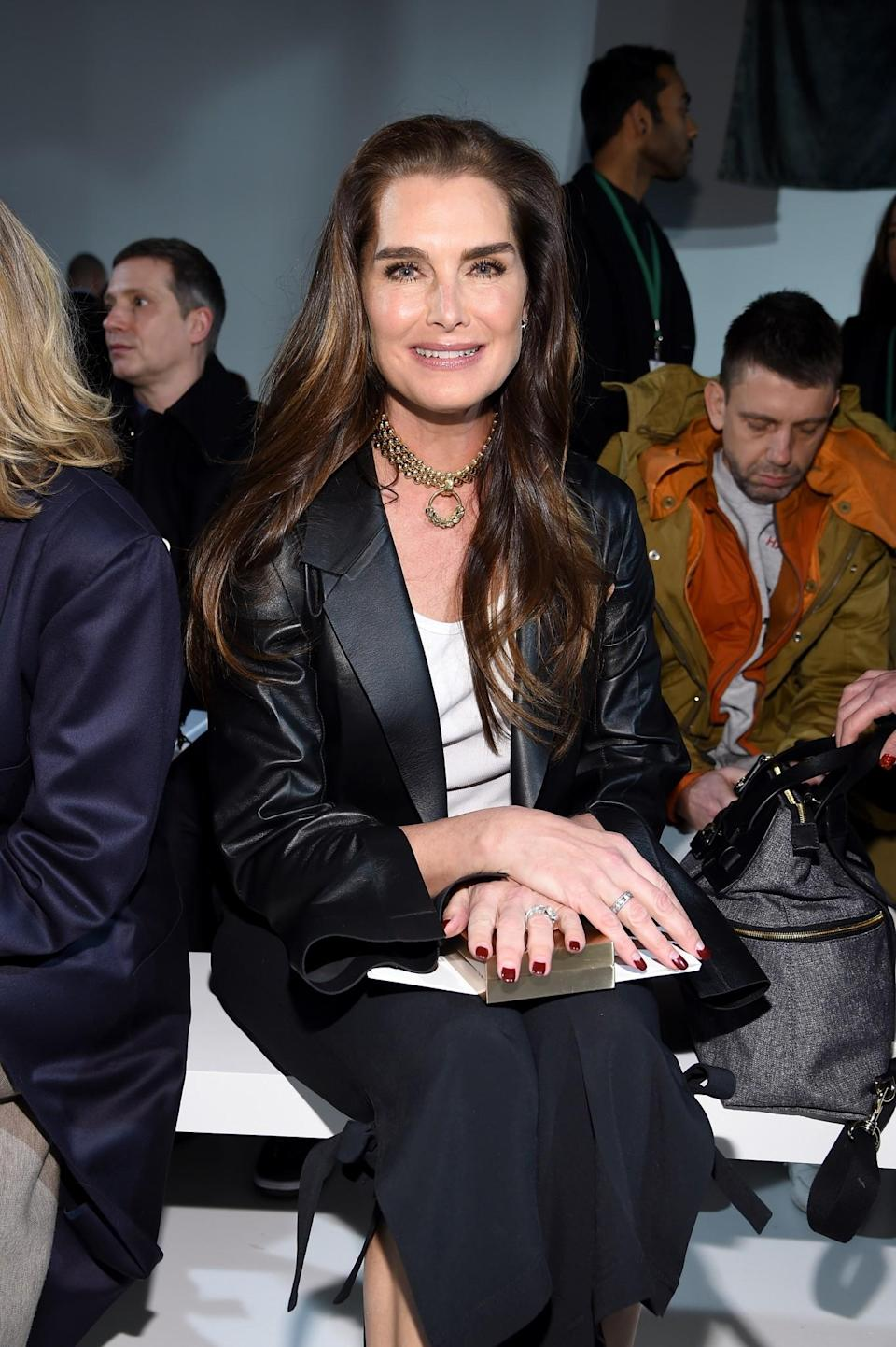 <p>Brooke Shields opted for a leather coat and statement necklace. <i>[Photo: Getty]</i> </p>