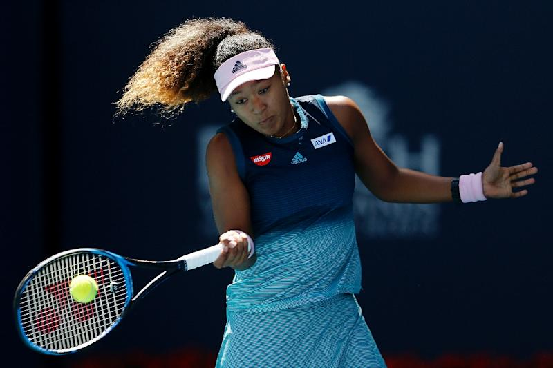 Japan's Naomi Osaka had to keep her emotions in check as she opened her campaign by outlasting Yanina Wickmayer 6-0, 6-7 (3/7), 6-1 (AFP Photo/Michael Reaves)
