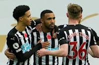 Newcastle striker Callum Wilson (C) grabbed both goals against Everton