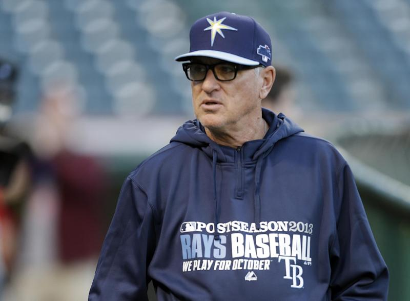 Tampa Bay Rays manager Joe Maddon walks the field during batting practice before the AL wild-card baseball game against the Cleveland Indians, Wednesday, Oct. 2, 2013, in Cleveland. (AP Photo/Tony Dejak)