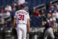 Washington Nationals starting pitcher Max Scherzer watches as Atlanta Braves' Dansby Swanson rounds the bases after hitting a solo home run in the second inning of an opening day baseball game at Nationals Park, Tuesday, April 6, 2021, in Washington. (AP Photo/Alex Brandon)