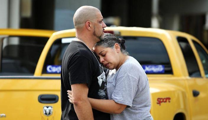 Ray Rivera, a DJ at Pulse nightclub in Orlando, is consoled by a friend outside of the Orlando Police Department after a mass shooting early Sunday morning that left at least 50 people dead. (Photo: Joe Burbank/Orlando Sentinel via AP)