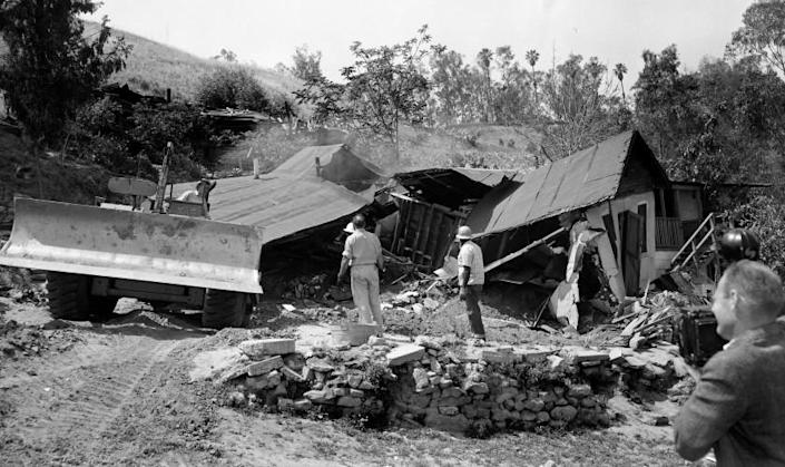 May 8, 1959: A bulldozer razes the Arechigas family home in Chavez Ravine immediately after family members, who had refused to leave, were forcibly removed. Homes were removed to make way for Dodger Stadium. Most homes in Chavez Ravine were removed in early 1950s for proposed development that fell through. Only a few homes were left in 1959 to be removed.